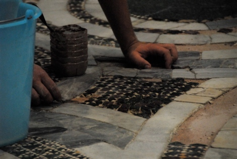 Conservator at work on the cathedral's thirteenth-century pavement