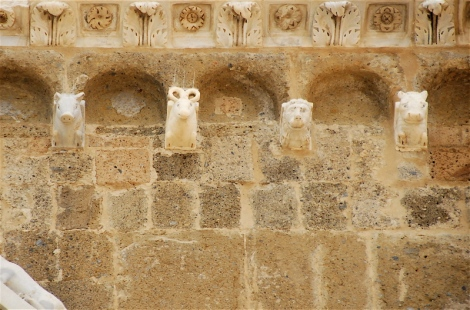 Figural corbels, façade, cathedral of Sessa Aurunca, the pig is the first on the left