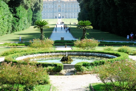 Fountain in the Gardens of the Reggia di Caserta, the garden front of the Palace visible in the distance